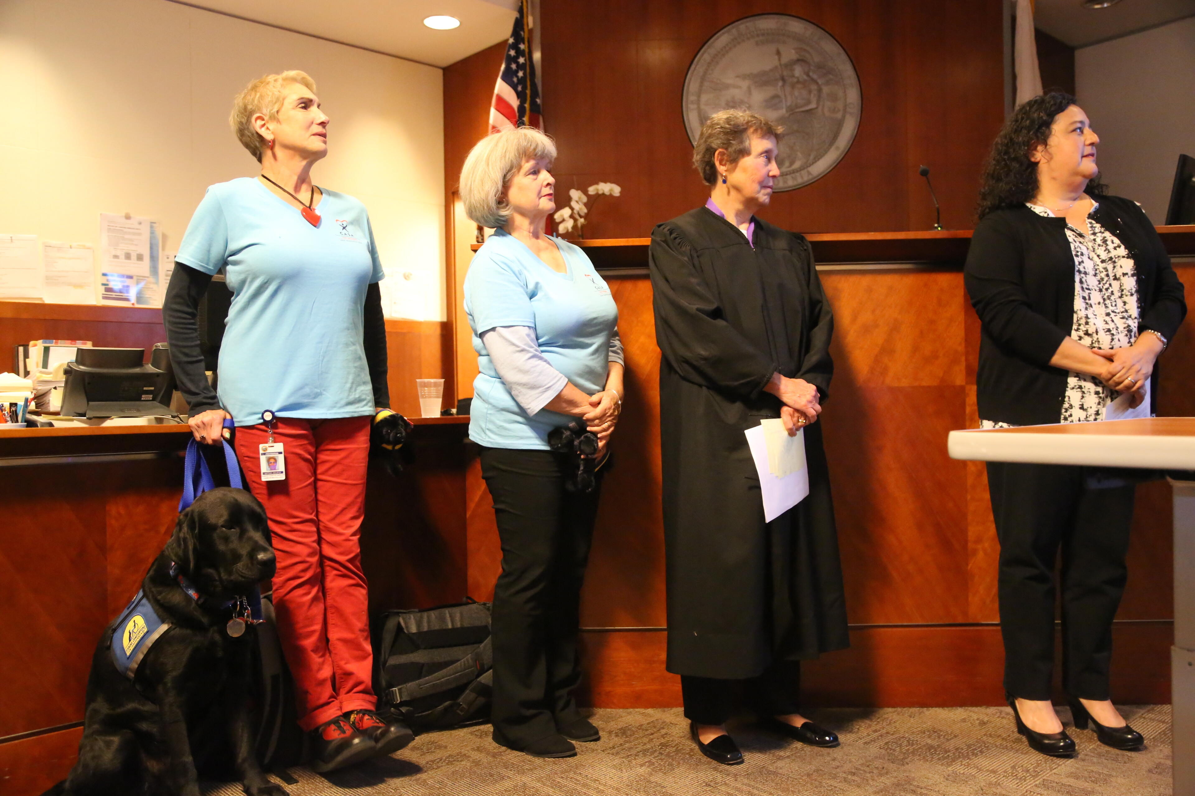 On August 25, Nemo, the young black Labrador Retriever, was sworn in as a courthouse dog. He is pictued with his two CASA handlers, Judge Nancy Davis and SFCASA Executive Director, Renee Espinoza.