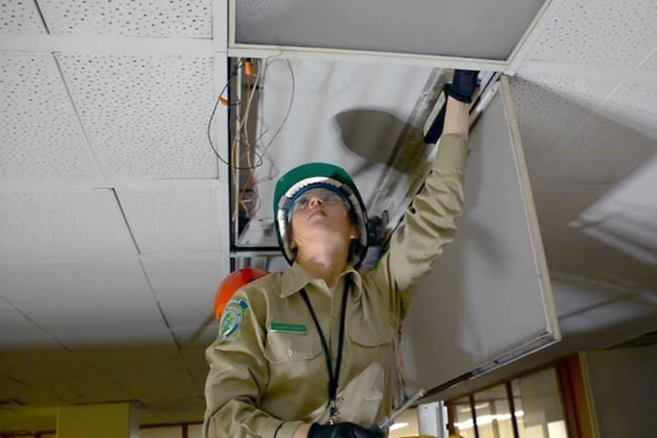 California Conservation Corps members work nightly at the Stanley Mosk Courthouse in Los Angeles to retrofit the existing light fixtures to new LED lamps. Photo: Courtesy of the California Conservation Corps