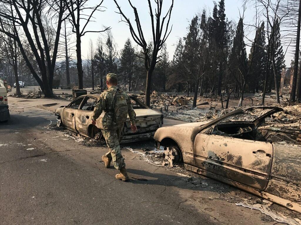 A member of the California National Guard searches the wreckage in Santa Rosa (Courtesy: California National Guard).