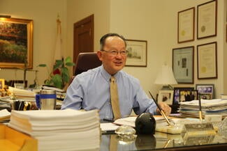 justice chin at desk in chambers