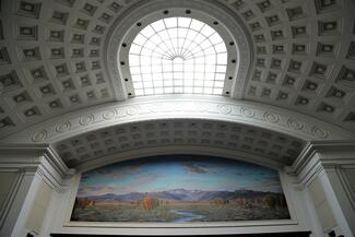 Supreme Court mural above bench