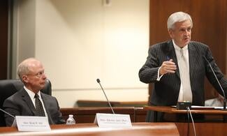 Justice Brad Hill (right) explains how public comment helped his committee finalize the priority list for new courthouse construction projects. Judge Steven Jahr (Ret.) (left) later took the council through the reprioritization process.
