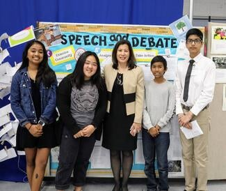 The Chief Justice congratulates students at Orange County's Lexington Junior High School, one of three winners of the top civics award.